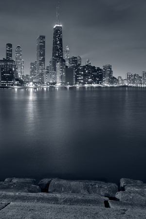 Chicago. Image of Chicago skyline and Lake Michigan coastline at night. photo