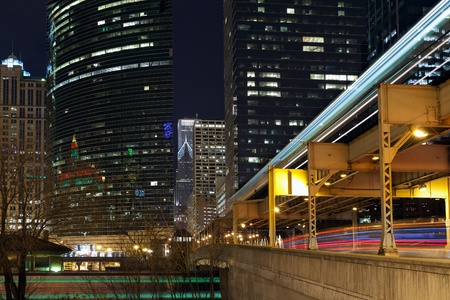 Chicago Transportation. In this image are captured three kind of Chicagos  transportation types in motion. ( train, elevated subway  and local bus) photo