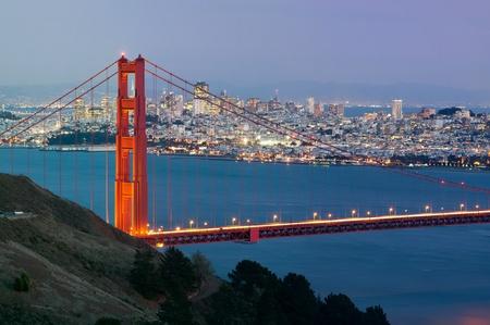 san: San Francisco. Image of Golden Gate Bridge with San Francisco skyline in the background.
