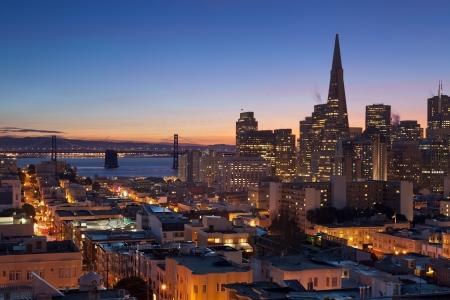 San Francisco. Image of San Francisco skyline with Bay Bridge at twilight. Stock Photo