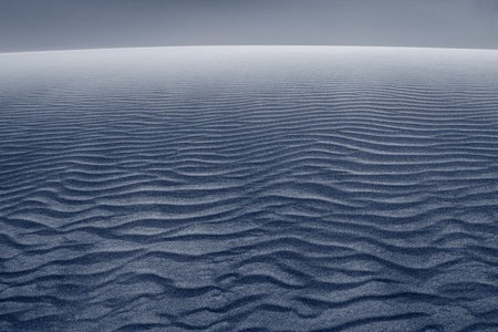 Sand dune. Close up image of wave patterns in sand dune after sunset. photo