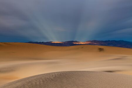 Sunbeams and desert Stock Photo - 12693085