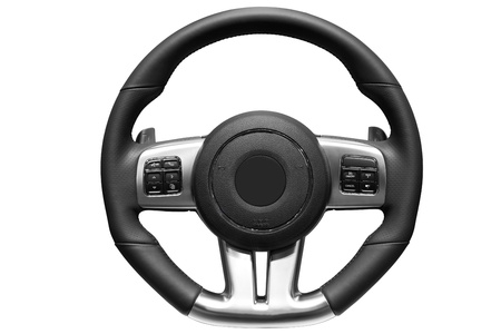 Sports car steering wheel. Close up image of modern sports car steering wheel.