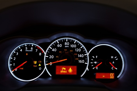 kilometer: Car Dashboard. Close up image of illuminated car dashboard.