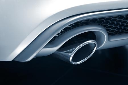 muffler: Exhaust Pipe. Toned image of new luxury car exhaust.