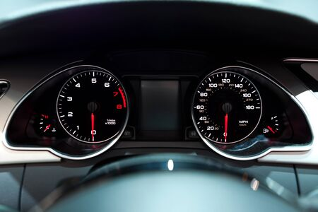Car Dashboard. Close up image of illuminated car dashboard. photo