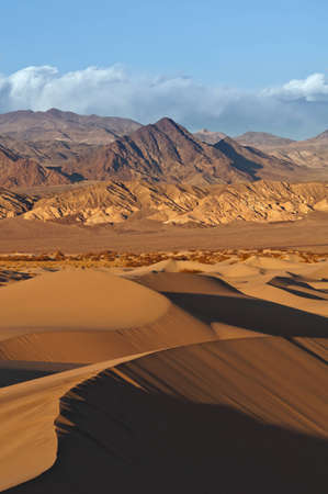 Death Valley. Image of rocky desert in Death Valley National Park with Mesquite Sand Dunes in the foreground. Stock Photo - 12693615