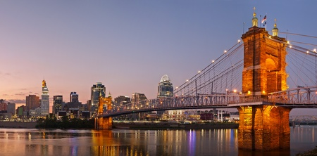 Cincinnati skyline panorama. Image of Cincinnati and John A. Roebling suspension bridge at twilight.