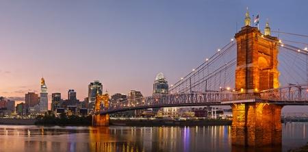 ohio: Cincinnati skyline panorama. Image of Cincinnati and John A. Roebling suspension bridge at twilight.