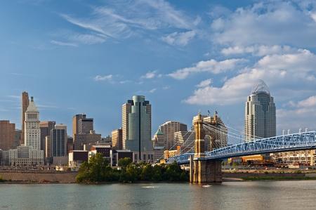 Cincinnati skyline. Image of Cincinnati skyline and historic John A. Roebling suspension bridge cross Ohio River. Stock Photo