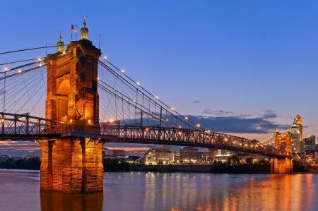 Cincinnati. Image of Cincinnati and John A. Roebling suspension bridge at twilight.