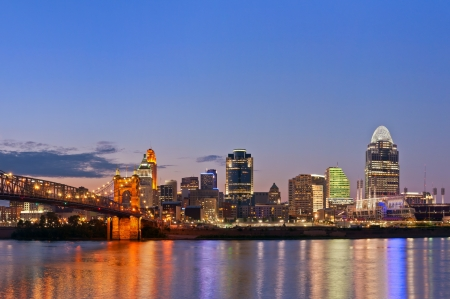 Cincinnati skyline. Image of Cincinnati and John A. Roebling suspension bridge at twilight.