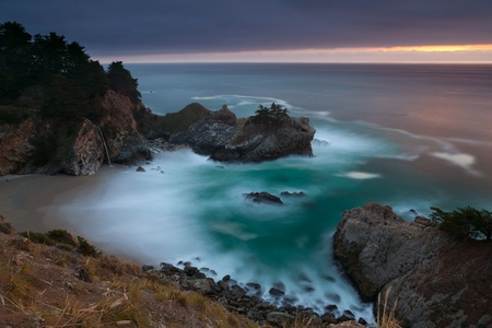 sur: Pacific coastline. McWay Falls at Julia Pfeiffer Burns State Park Big Sur California.