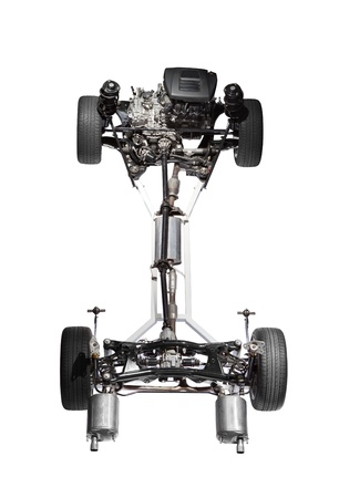 chassis: Car chassis with engine. Image of car chassis with engine isolated on white. Stock Photo