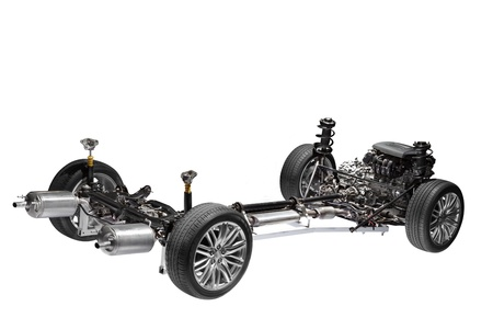 Car chassis with engine  Image of car chassis with engine isolated on white  Stock Photo