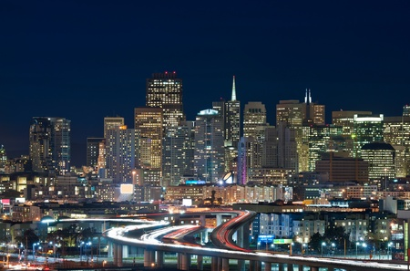 night traffic: San Francisco. Image of San Francisco skyline and busy highway leading to the city. Stock Photo