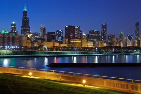 the sears tower: Chicago skyline. Image of Chicago skyline at night with reflection of the city lights in Lake Michigan. Stock Photo