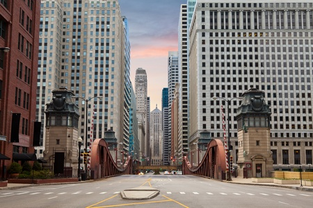 Street of Chicago. Image of La Salle street in Chicago downtown at the sunrise. Stock Photo