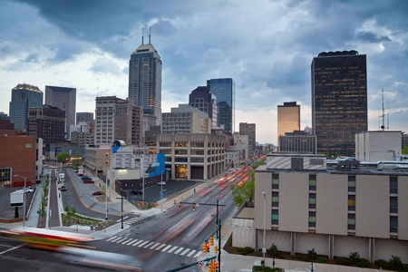 indianapolis: Indianapolis. Image of the Indianapolis skyline with busy traffic and dramatic sky. Stock Photo