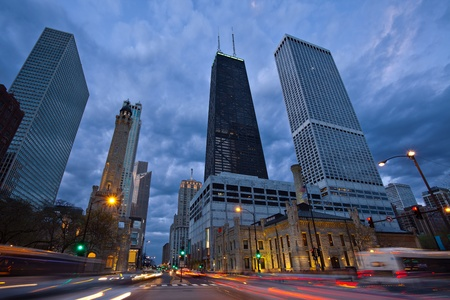 michigan avenue: Michigan Avenue in Chicago. Image of busy traffic at the street of Chicago during  sunset blue hour.