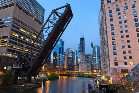 Chicago downtown riverside. Image of the Chicago downtown area and a old drawbridge at twilight. photo