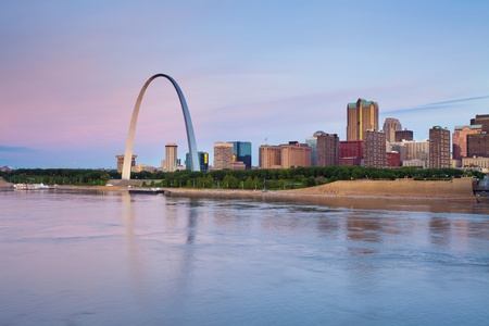 st  louis arch: St. Louis. Image of St. Louis downtown with Gateway Arch at twilight.
