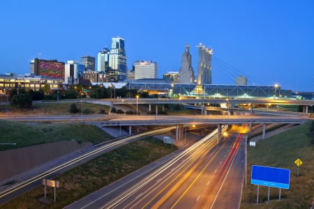 city scenes: Kansas City. Image of the Kansas City skyline and busy highway system leading to the city.