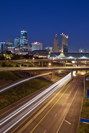 busy city: Kansas City. Image of the Kansas City skyline and busy highway system leading to the city.
