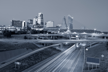 Kansas City  Toned image of the Kansas City skyline and busy highway system leading to the city