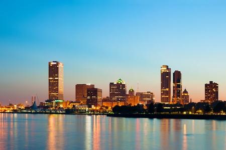 City of Milwaukee skyline. Image of Milwaukee skyline at twilight with city reflection in lake Michigan. photo