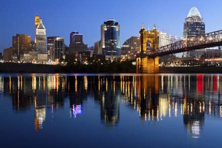 Cincinnati skyline. Image of Cincinnati and John A. Roebling Suspension Bridge at twilight.  Stock Photo