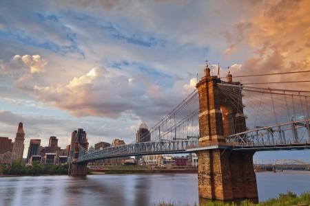 Cincinnati. Image of Cincinnati and John A. Roebling suspension bridge at sunset.