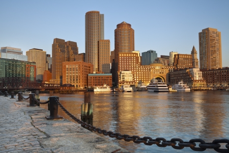 boston skyline: City of Boston. Image of Boston city skyline at sunrise.
