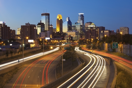 minnesota: Minneapolis. Image of Minneapolis skyline and highway with traffic lines leading to the city. Stock Photo