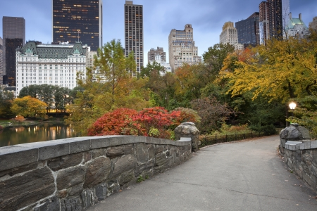 fall sunrise: Central Park and Manhattan Skyline. Image of Central Park and Gapstow Bridge in New York City, USA in Autumn.  Stock Photo