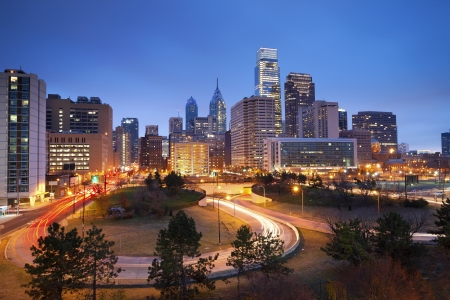 philadelphia: Philadelphia. Image of Philadelphia skyline and busy roads during twilight blue hour.