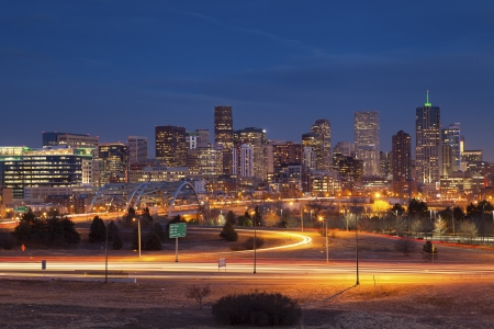 Denver Skyline. Image of Denver Skyline and busy highway in the foreground.