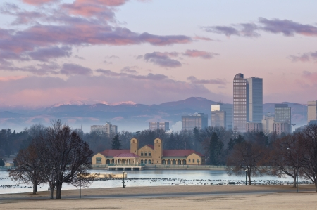 denver skyline at sunrise: Denver. Image of Denver at sunrise with Rocky Mountains in the background. Stock Photo
