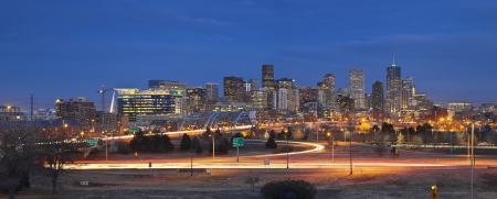 Denver Skyline. Panoramic image of Denver skyline and busy highway in the foreground. Stock Photo