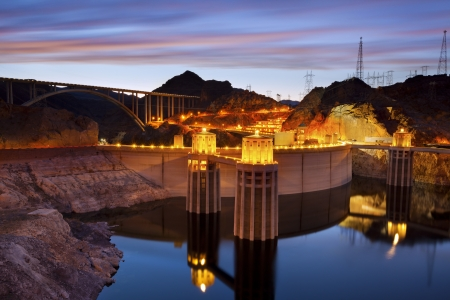 Hoover Dam and Hoover Bridge at twilight blue hour.