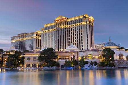 caesars palace: Caesars Palace Hotel Casino. Las Vegas, Nevada, USA - January 7, 2013: Luxurious hotel Caesars Palace at twilight, located at the Paradise area in the Las Vegas Strip, as seen over the Bellagio Lake. Editorial