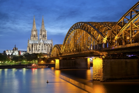 Cologne, Germany Image of Cologne with Cologne Cathedral and Hohenzollern bridge across the Rhine River