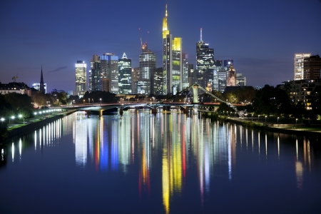Frankfurt am Main  Image of Frankfurt skyline after sunset with the reflection of the city in Main River