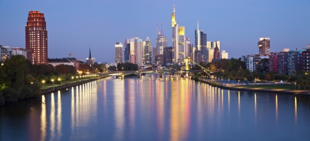 main river: Frankfurt am Main  Panoramic image of Frankfurt skyline in the morning with the reflection of the city lights in Main River