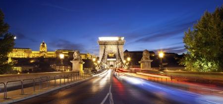 Szechenyi Chain Bridge, Budapest  Image of Chain Bridge and Royal Palace of Buda in Budapest during sunset Stock Photo - 23117526