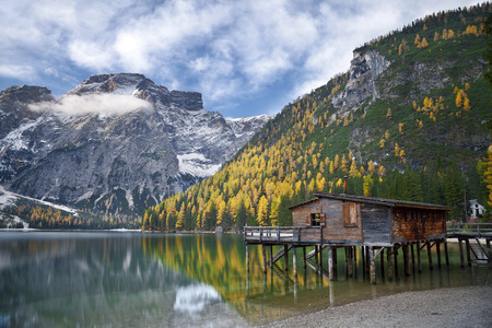 Autumn in Alps  Idyllic lake surrounded by colorful trees in the Italian Alps