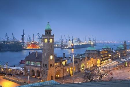 hamburg: Hamburg, Germany  Image of Landungsbruecken and the harbor at night in Hamburg, Germany