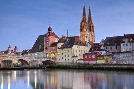 Regensburg  Image of unesco heritage and historic bavarian city Regensburg with cathedral and old stone bridge over river Danube in Germany  Standard-Bild