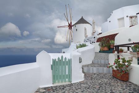 tourist feature: Santorini  Image of Oia, small village, located on beautiful greek island Santorini, during sunrise