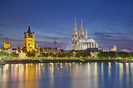 Cologne, Germany  Image of Cologne with Cologne Cathedral during twilight blue hour  photo